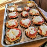 eggplant parmesan rounds on a baking sheet