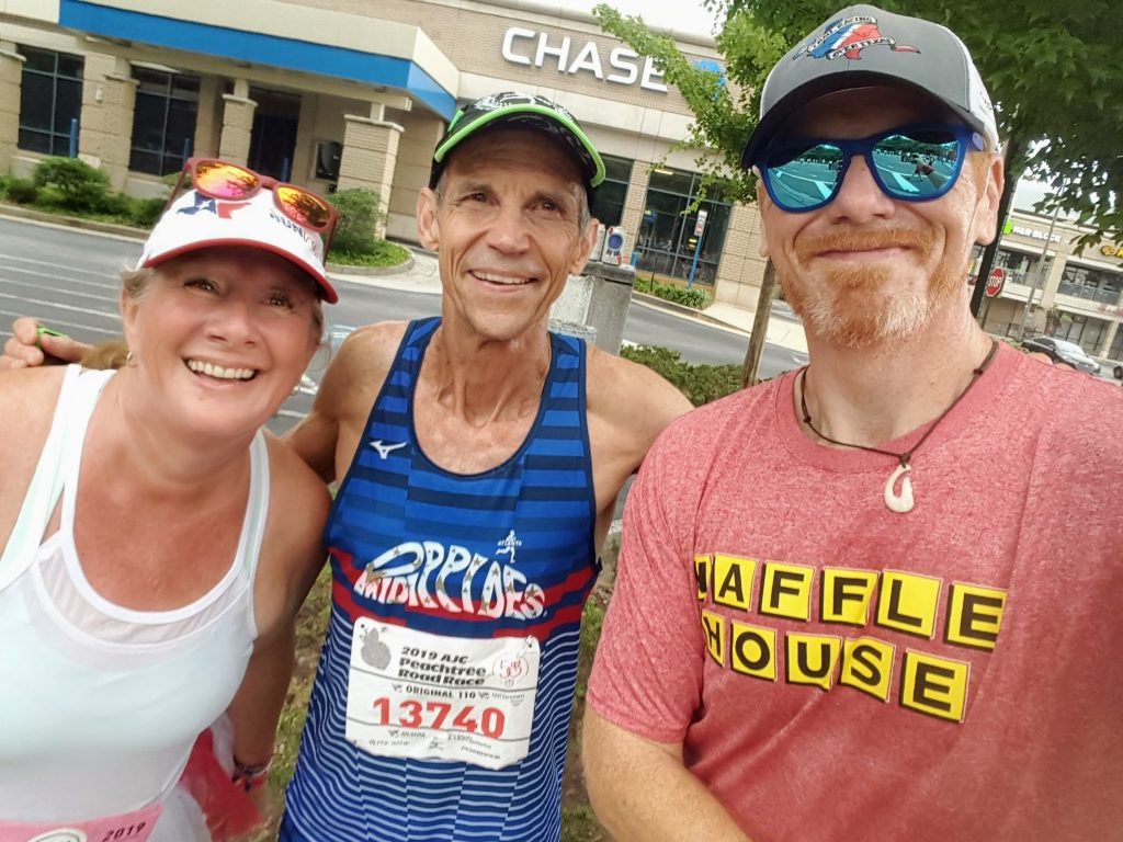 Sandy, Jeff Galloway, and Lloyd at the Peachtree Road Race 2019